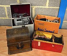 THREE VINTAGE PROJECTORS together with Edison fireside photograph. (4)