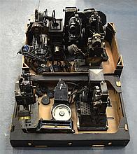 A COLLECTION OF NINE VINTAGE PROJECTORS & PATHESCOPES of various forms and