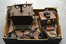 A GROUP OF ANTIQUE TELEPHONES of various forms and sizes. (4)