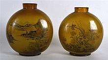 A VERY LARGE PAIR OF EARLY 20TH CENTURY SMOKEY GLASS SNUFF BOTTLES painted