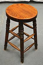 A CARVED WOOD MILK CHURNING STOOL. 2Ft 1ins high.