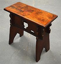 A 19TH CENTURY CARVED WOOD RECTANGULAR STOOL. 1Ft 9ins high.