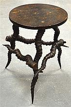 AN ANTIQUE ANTLER AND LACQUERED WOOD STOOL. 1Ft 5.5ins high.