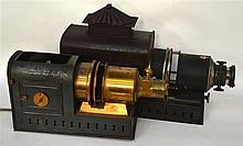 A VICTORIAN HOUGHTON BUTCHER MAGIC LANTERN together with another smaller la