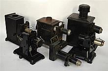 A GROUP OF SIX EARLY 20TH CENTURY TINPLATE LANTERN/PROJECTORS of various si