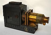 A VICTORIAN MAGIC LANTERN with brass lens. 1Ft 8ins wide.
