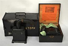 A BOXED GERMAN MAGIC LANTERN together with another tinplate lantern part