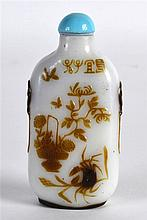A CHINESE QING DYNASTY BROWN OVERLAID SNUFF BOTTLE AND STOPPER Yangzhou Sch