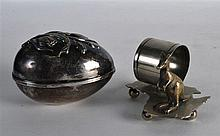 A NOVELTY KANGAROO NAPKIN RING together with a white metal egg. (2)