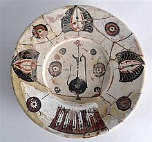 A Large Nishapur Persian Dish, painted with kufic calligraphy, 9th/10th Cen