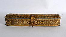 A GOOD TURKISH GOLD INLAID OVAL PEN BOX decorated with scrolling motifs and