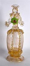 A GOOD VENETIAN CLEAR AND GILT SPRAYED GLASS FIGURE OF A STANDING FEMALE mo