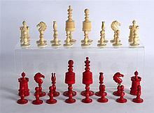 AN EARLY 19TH CENTURY EUROPEAN STAINED IVORY CHESS SET within an associated