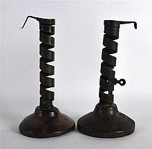 A PAIR OF ANTIQUE FRENCH CARVED WOOD AND SPIRAL TWIST CANDLESTICKS. 7.5ins