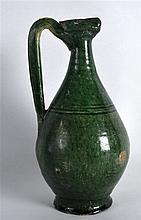 A PERSIAN GREEN GLAZED JUG 9th/10th Century, with high loop handle and inci