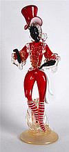AN UNUSUAL VENETIAN RED AND WHITE GLASS FIGURE modelled wearing a top hat,