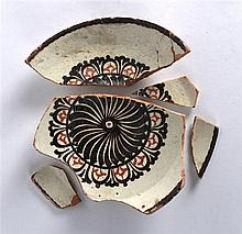A Persian Cream Ground Nishapur Plate, 9th/10th Century, painted with a cen