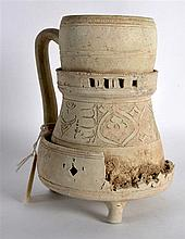 An Unusual Fitted 9th/10th Century Persian Jug on stand, incised with flora