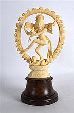 AN EARLY 20TH CENTURY ANGLO INDIAN CARVED IVORY FIGURE modelled as a buddhi