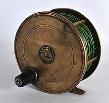 AN ANTIQUE SCOTTISH FISHING REEL stamped P D Malloch Perth. 4.5ins diameter