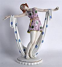 AN EARLY 20TH CENTURY ART DECO SITZENDORF FIGURE OF A FLAPPER GIRL modelled