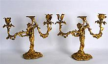 A PAIR OF FRENCH ORMOLU TWIN BRANCH CANDLEABRA in the form of males blowing