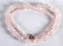 A 24INCH ROSE QUARTZ NECKLACE with 9ct gold clasp.