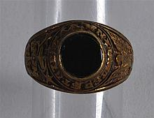 A US MILITARY NAVAL RING inset with a black stone.