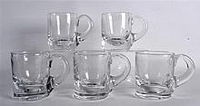 A SET OF FIVE 19TH CENTURY HEAVY CLEAR GLASS MUGS. (5)