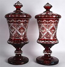 A FINE PAIR OF VERY LARGE BOHEMIAN RUBY GLASS GOBLETS AND COVERS engraved a