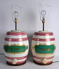 A PAIR OF ANTIQUE POTTERY GIN AND RUM BARREL JARS converted to lamps. Each