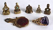 AN EARLY 19TH CENTURY GOLD SWIVEL FOB SEAL together with six other antique