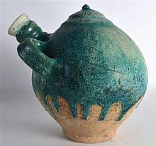 A Good 8th/9th Century Persian blue glazed gourd vessel, with twin loop han