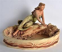 AN EARLY 20TH CENTURY AUSTRIAN PAINTED POTTERY FIGURAL CENTREPIECE modelled