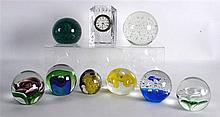 A WATERFORD CRYSTAL CUT GLASS CLOCK together with eight paperweights. (9)