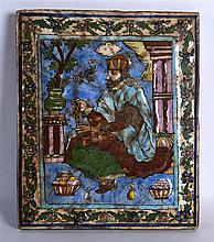 A PERSIAN PAINTED POTTERY TILE depicting a single seated male holding praye