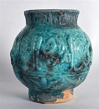An Islamic Blue Jar, 19th Century, decorated with motifs. 4.75ins high.