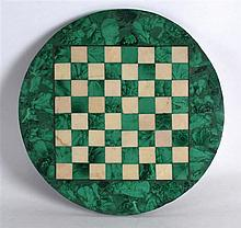 AN ART DECO MALACHITE AND WHITE MARBLE CHESS BOARD of naturalistic form. 9.