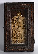 AN UNUSUAL EARLY INDIAN CARVED TERRACOTTA RELIC contained within a wooden c