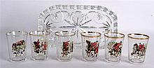 A RETRO FRENCH PAINTED FOX HUNTING SHOT GLASSES  ON STAND. (7)