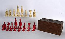 AN EARLY 19TH CENTURY CARVED AND STAINED EUROPEAN BONE CHESS SET within an