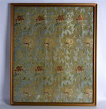 A FRAMED EARLY 20TH CENTURY INDIAN SILK WORK EMBROIDERY decorated with flow