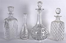 A GOOD QUALITY 19TH CENTURY DECANTER AND STOPPER together with three others