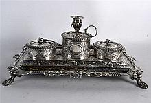 A GOOD GEORGE III RECTANGULAR SILVER DESK STAND with twin inkwell, decorate