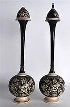 A PAIR OF EARLY 20TH CENTURY INDIAN ROSEWATER SPRINKLERS decorated with flo