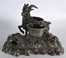 A 19TH CENTURY CONTINENTAL SILVER PLATED TWIN INKWELL in the form of a roa