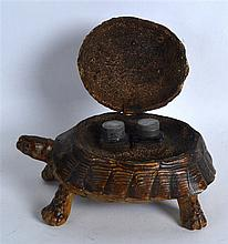 AN UNUSUAL EDWARDIAN CARVED TORTOISESHELL INKWELL of naturalistic form, wit