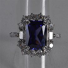 A SILVER AND BLUE STONE FANCY RING.