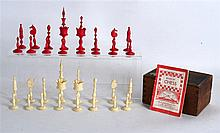 A SMALL EARLY 19TH CENTURY PARTIAL STAINED BONE CHESS SET within an associa