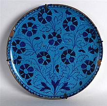 A 19TH CENTURY TURKISH OR PERSIAN BLUE GROUND DISH painted with dark blue f